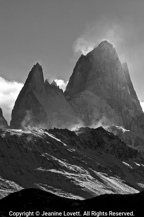 Argentina's Fritz Roy jagged mountain tops and extreme winds kick up the ice from the granite peaks catching the light creating an ethereal glow.