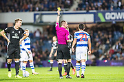 yellow card for QPR (21) Massimo Luongo during the EFL Sky Bet Championship match between Queens Park Rangers and Fulham at the Loftus Road Stadium, London, England on 29 September 2017. Photo by Sebastian Frej.
