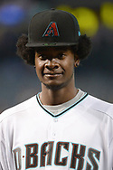 PHOENIX, AZ - JUNE 23:  Josh Jackson of the Phoenix Suns wears a Arizona Diamondbacks cap and jersey while throwing out the ceremonial first pitch for the Philadelphia Phillies and Arizona Diamondbacks MLB game at Chase Field on June 23, 2017 in Phoenix, Arizona. Jackson is the Phoenix Suns 2017 first-round draft pick.  (Photo by Jennifer Stewart/Getty Images)