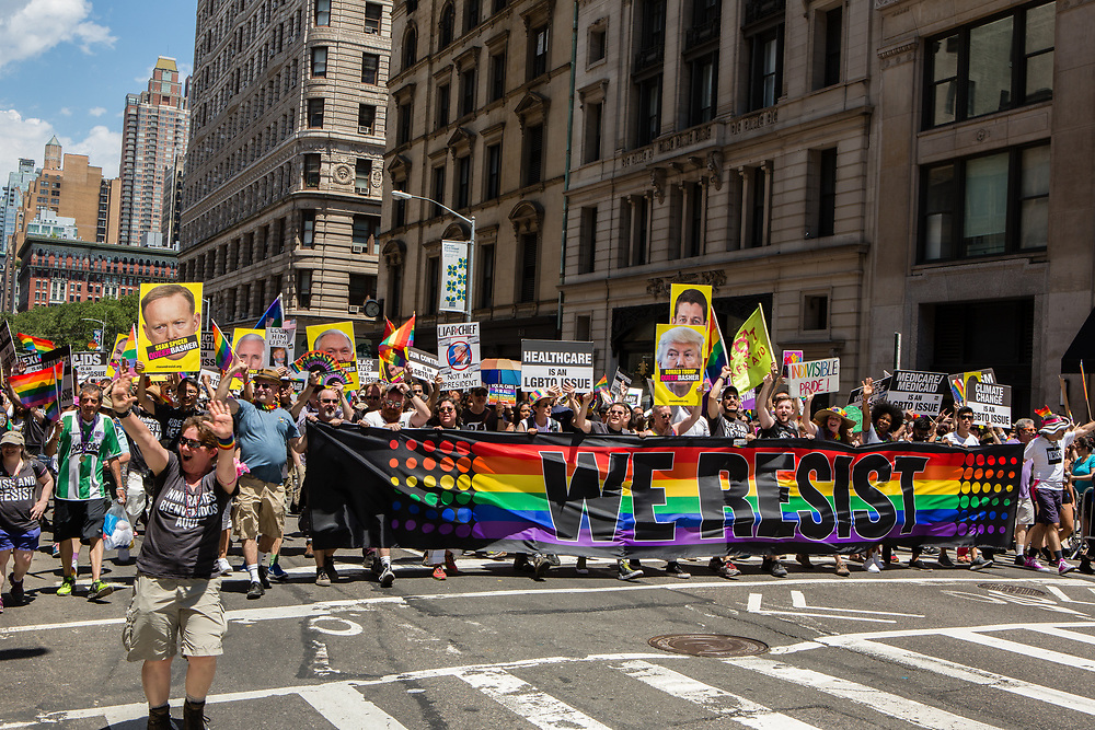 New York, NY - 25 June 2017. New York City Heritage of Pride March filled Fifth Avenue for hours with groups from the LGBT community and it's supporters. A large contingent of marchers from Rise and Resist.