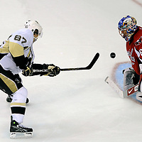 08 March 2009:  Pittsburgh Penguins center Sidney Crosby (87) scores the winning goal  in a shootout against Washington Capitals goalie Jose Theodore (60) at the Verizon Center in Washington, D.C.  The Penguins defeated the Capitals 4-3 in a shootout to send the Capitals to their fourth consecutive defeat.