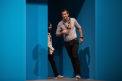 © Licensed to London News Pictures  . 03/10/2017 . Manchester , UK . Chief Scout BEAR GRYLLS (r) enters the stage with FERDOUS AL-AUDHALI (22 from Solihull) to speak on stage ahead of the Home Secretary , during day three of the Conservative Party Conference at the Manchester Central Convention Centre . Photo credit : Joel Goodman/LNP
