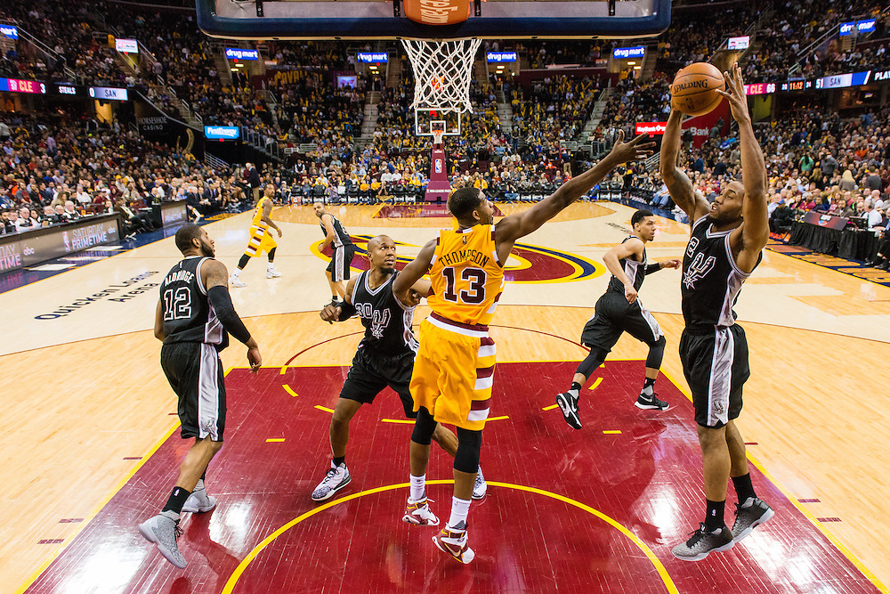 CLEVELAND, OH - JANUARY 30: Kawhi Leonard #2 of the San Antonio Spurs grabs a rebound over Tristan Thompson #13 of the Cleveland Cavaliers during the third quarter at Quicken Loans Arena on January 30, 2016 in Cleveland, Ohio. The Cavaliers defeated the Spurs 117-103. NOTE TO USER: User expressly acknowledges and agrees that, by downloading and/or using this photograph, user is consenting to the terms and conditions of the Getty Images License Agreement. Mandatory copyright notice. (Photo by Jason Miller/Getty Images) *** Local Caption ***Kawhi Leonard; Tristan Thompson