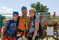 "Sarah, Dave and Nicole Epstein of Bow finish their ""prep"" zip at the mountain base and prepare to ride the Panorama Lift to the top for their Zipline adventure at Gunstock Mountain Resort.  (Karen Bobotas/for the Laconia Daily Sun)"