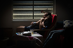 September 10, 2017 - Fort Lauderdale, Florida, U.S - RAZ BEN-EZZER of Fort Lauderdale comforts his son  JESSE (3) during  a power outage caused by hurricane Irma. (Credit Image: © Orit Ben-Ezzer via ZUMA Wire)