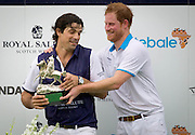 May 4, 2016 - Wellington, FL, United States - <br /> <br /> Nacho Figueras wrestles away the winner's trophy from the hands of Prince Harry after competing in a charity polo match in Wellington, Florida on May 4, 2016.<br /> ©Exclusivepix Media