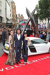 © Licensed to London News Pictures. Tao Okamoto, Hugh Jackman, Rila Fukashima at The Wolverine UK film premiere, Leicester Square, London UK, 16 July 2013. Photo by Richard Goldschmidt/LNP