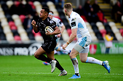 Ashton Hewitt of Dragons is chased by Brandon Thomson of Glasgow Warriors  - Ryan Hiscott/JMP - 25/10/19 - SPORT - Rodney Parade - Newport, Wales -
