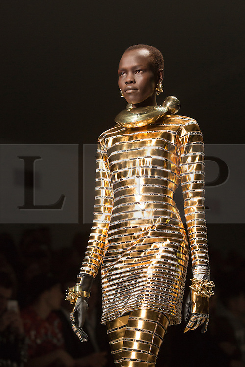 © Licensed to London News Pictures. 18 February 2014, London, England, UK. A model walks the runway at the KTZ show during London Fashion Week AW14 at the BFC Courtyard Show Space/Somerset House. Photo credit: Bettina Strenske/LNP