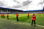 Heavy steward presence to avoid a pitch invasion after the EFL Sky Bet Championship match between Queens Park Rangers and Nottingham Forest at the Loftus Road Stadium, London, England on 27 April 2019.