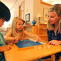 Adam Robison | BUY AT PHOTOS.DJOURNAL.COM<br /> Misty Coleman works with students Justin Ho, 4 and Tessa Kate Lesley, 3