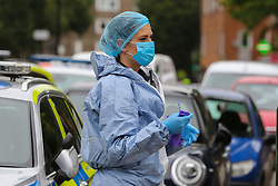 © Licensed to London News Pictures. 04/07/2020. London, UK. A forensic officer on Roman Way, Islington in north London as police launch a murder investigation following fatal shooting. Police were called at at 3.20pm to Roman Way, following reports of shots fired.  Officers attended with LAS and found a man, believed to be aged in his early 20s, suffering from gunshot injuries. Despite their best efforts, he was pronounced dead at the scene. Photo credit: Dinendra Haria/LNP