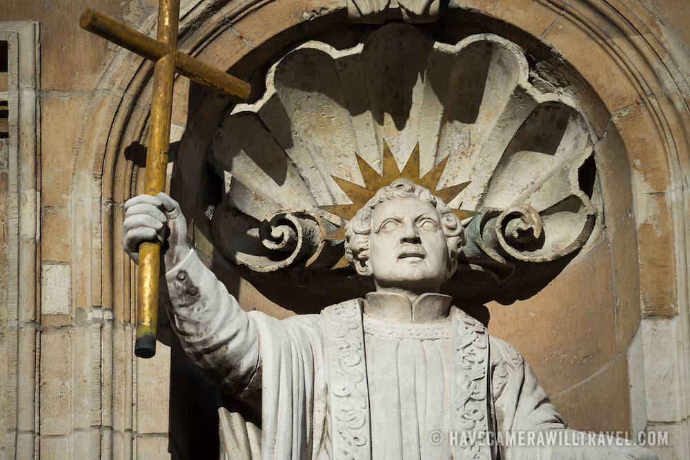 A religious statue on the outside of a church in Bruges, Belgium.
