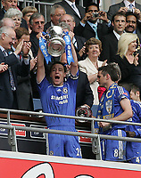 Photo: Lee Earle.<br /> Chelsea v Manchester United. The FA Cup Final. 19/05/2007.Chelsea captain John Terry lifts the FA cup.