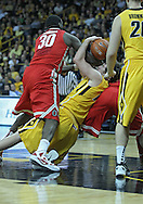 January 07, 2011: Iowa Hawkeyes forward Zach McCabe (15) tries to pass the ball as Ohio State Buckeyes forward Evan Ravenel (30) tries to grab it during the the NCAA basketball game between the Ohio State Buckeyes and the Iowa Hawkeyes at Carver-Hawkeye Arena in Iowa City, Iowa on Saturday, January 7, 2012.