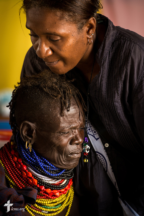 Shara Cunningham, career missionary in Eastern and Southern Africa, comforts a patient during the LCMS Mercy Medical Team on Tuesday, June 21, 2016, in Nataparkakono, a village in Turkana, Kenya.  LCMS Communications/Erik M. Lunsford
