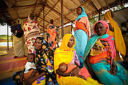 Women wait with their babies to be seen by doctors at a free clinic in Gouroukoun IDP camp near Goz Beida, in eastern Chad.
