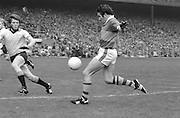 Kerry's John Egan steadies himself to shoot for a point with Dublin's Tommy Drum approaching him during the All Ireland Senior Gaelic Football Final Dublin v Kerry in Croke Park on the 26th September 1976. Dublin 3-08 Kerry 0-10.