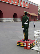 soldier standing guard at the entrance to the Forbidden City Beijing
