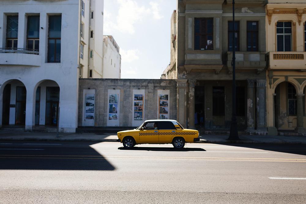 Cab drives along the Malecon in Old Havana, Havana Cuba
