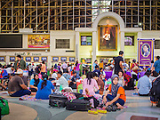 11 APRIL 2015 - BANGKOK, THAILAND:  People wait in the main concourse to board trains at Hua Lamphong train station in Bangkok. More than 130,000 passengers streamed through Bangkok's main train station Friday ahead of Songkran, Thailand's traditional new year celebration. Songkran will be celebrated April 13-15 but people started streaming out of Bangkok on April 10 to go back to their home provinces.   PHOTO BY JACK KURTZ