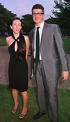 MR & MRS JAY JOPLING they are the contemporary art experts, at a party in London on 7th July 1999.MUC 128
