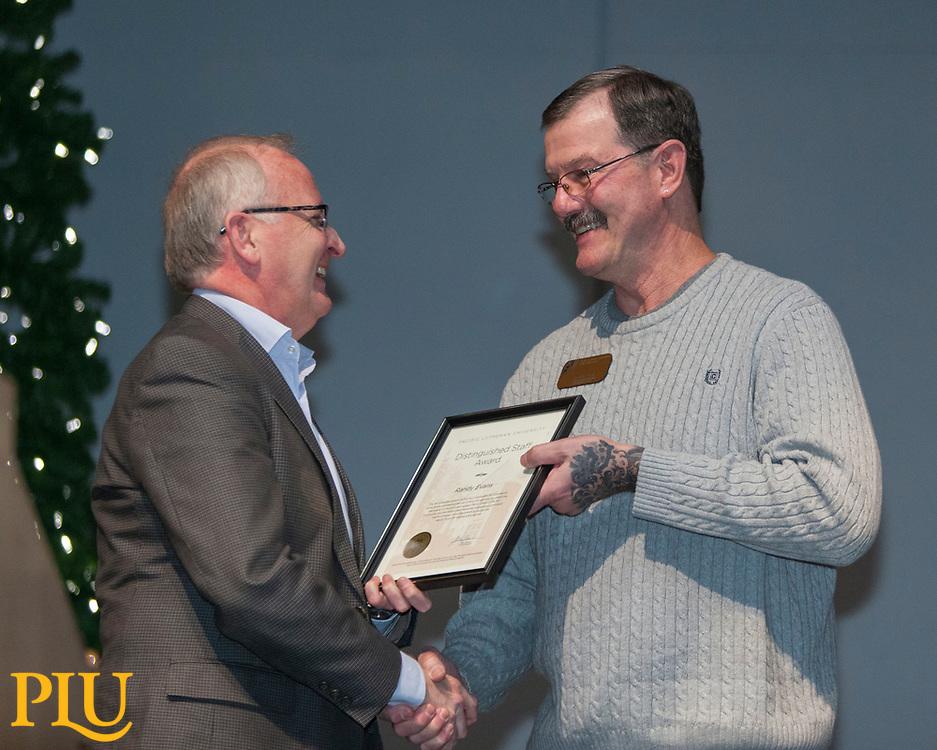 Allan Belton present an award to Randy Evans at the PLU Christmas Brunch, Thursday, Dec. 14, 2017. (Photo: John Froschauer/PLU)