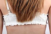 Back of a woman wearing a white bra