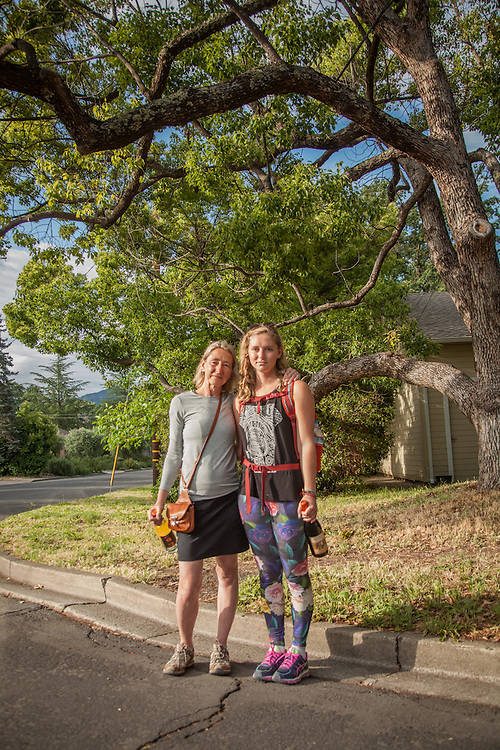 "Minneapolis adaptive yoga instrctor Kathy Dahl and her daughter Madi at Cedar and South Oak Streets in Calistoga.  ""Madi is attending school in Colorado so we decided to meet here and celebrate her 21st birthday...thus the wine bottles."""