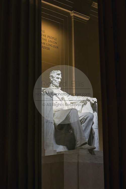 Lincoln Memorial interior view showing statue of President Abraham Lincoln at dawn in Washington, DC.