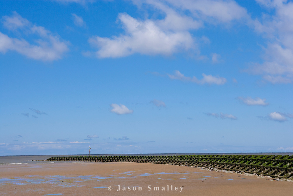 the beach and sea defences at New Brighton, the Wirral peninsula.