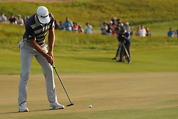 June 16, 2018 - Southampton, NY, USA - Dustin Johnson putting on the 18th green during the third round of the 2018 U.S. Open at Shinnecock Hills Country Club in Southampton, N.Y., on Saturday, June 16, 2018. (Credit Image: © Brian Ciancio/TNS via ZUMA Wire)