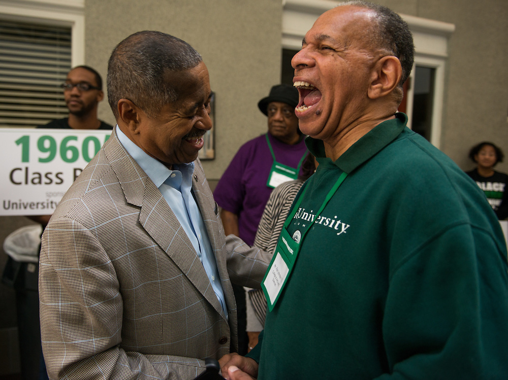 Ron Van Johnson, class of 1971, has a laugh with President Roderick McDavis during the Black Alumni Reunion Cookout.