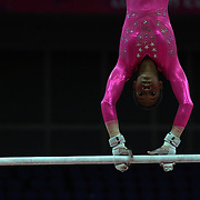 Gabrielle Douglas, USA, in action on the uneven bars during the Women's Artistic Gymnastics podium training at North Greenwich Arena during the London 2012 Olympic games preparation at the London Olympics. London, UK. 26th July 2012. Photo Tim Clayton