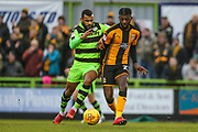 Cambridge United's Medy Elito(21) passes the ball under pressure from Forest Green Rovers Dan Wishart(17) during the EFL Sky Bet League 2 match between Forest Green Rovers and Cambridge United at the New Lawn, Forest Green, United Kingdom on 20 January 2018. Photo by Shane Healey.