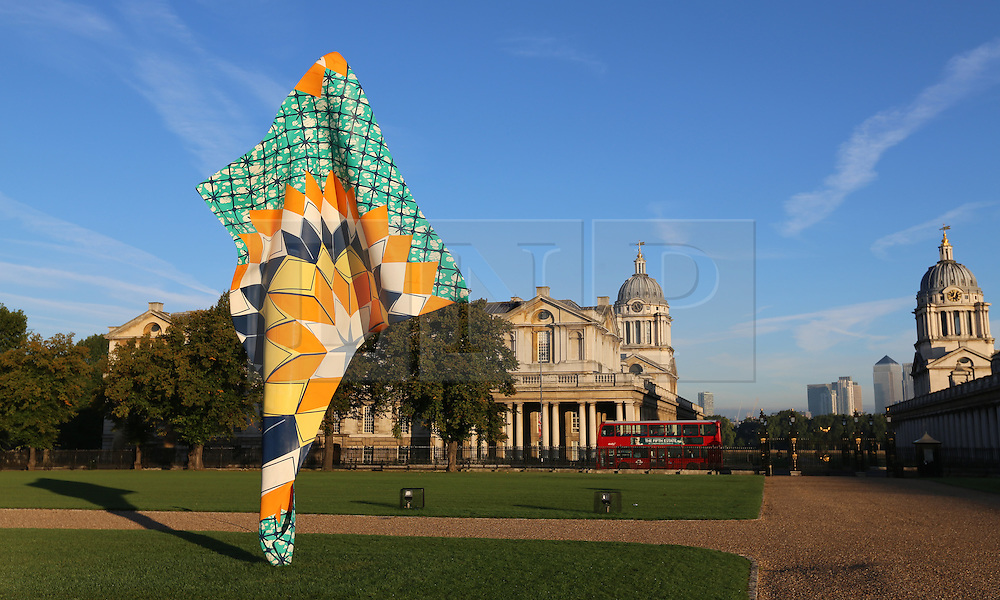 © Licensed to London News Pictures. 06/10/2013. A brand new sculpture by the artist Yinka Shonibare MBW in Greenwich in the morning sunshine. Greenwich got off to a gloriously sunny day this morning with temperatures to hit 22 degrees today. Credit : Rob Powell/LNP
