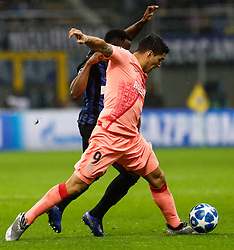 November 7, 2018 - Milan, Italy - Kwadwo Asamoah of Inter Milan and Luis Suarez (in front) of Barcelona vie for the ball during the Group B match of the UEFA Champions League between FC Internazionale and FC Barcelona on November 6, 2018 at San Siro Stadium in Milan, Italy. (Credit Image: © Mike Kireev/NurPhoto via ZUMA Press)