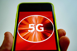 Vodafone first to launch 5G network in Netherlands. Vodafone is activating its 5G network in over half of the Netherlands on Tuesday evening. Customers who have a Red subscription and a phone that supports 5G should be able to use the faster mobile network within a week. Vodafone is the first Dutch provider to launch 5G. The network should be available to all Vodafone customers by the end of July, NU.nl reports. The Randstad, southern Netherlands, and large cities in other parts of the Netherlands will be the first to get 5G. Vodafone is using existing antennas and 4G frequency band to offer 5G. Photo by Robin Utrecht/ABACAPRESS.COM