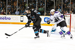 November 15, 2010; San Jose, CA, USA;  San Jose Sharks defenseman Jason Demers (60) skates past Los Angeles Kings right wing Justin Williams (14) during the first period at HP Pavilion. Mandatory Credit: Jason O. Watson / US PRESSWIRE