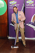 Anthony Anderson strikes a pose with a Swiffer WetJet at the unveiling of the docu-style #SwifferDad video that he helped create, Tuesday, April 14, 2015, in New York. The video celebrates the active role that dads play in sharing cleaning and household responsibilities.  (Photo by Diane Bondareff/Invision for Swiffer/AP Images)