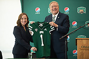 Ohio University President M. Duane Nellis gives new Athletic Director Julie Cromer a jersey at a press conference at Peden Stadium.