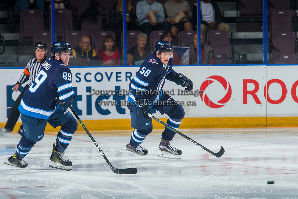 PENTICTON, CANADA - SEPTEMBER 8: Tyler Boland #89 and Jansen Harkins #58 of Winnipeg Jets skate for the puck against the Vancouver Canucks on September 8, 2017 at the South Okanagan Event Centre in Penticton, British Columbia, Canada.  (Photo by Marissa Baecker/Shoot the Breeze)  *** Local Caption ***