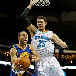 Jan 19, 2013; New Orleans, LA, USA; Golden State Warriors point guard Stephen Curry (30) is fouled by New Orleans Hornets shooting guard Austin Rivers (25) during  the second half of a game at the New Orleans Arena. The Warriors defeated the Hornets 116-112. Mandatory Credit: Derick E. Hingle-USA TODAY Sports