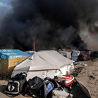 26th October 2016, The Jungle of Calais in France is in huge fire. Bags of migrants.