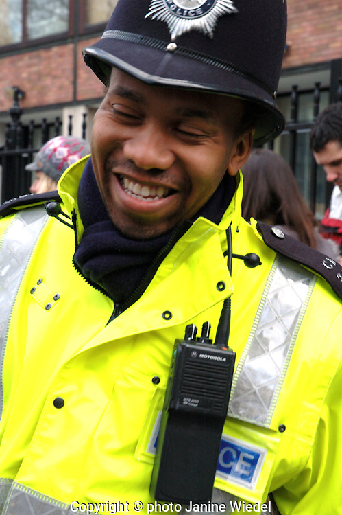 Young black policeman at a demonstration on Climate change in London.