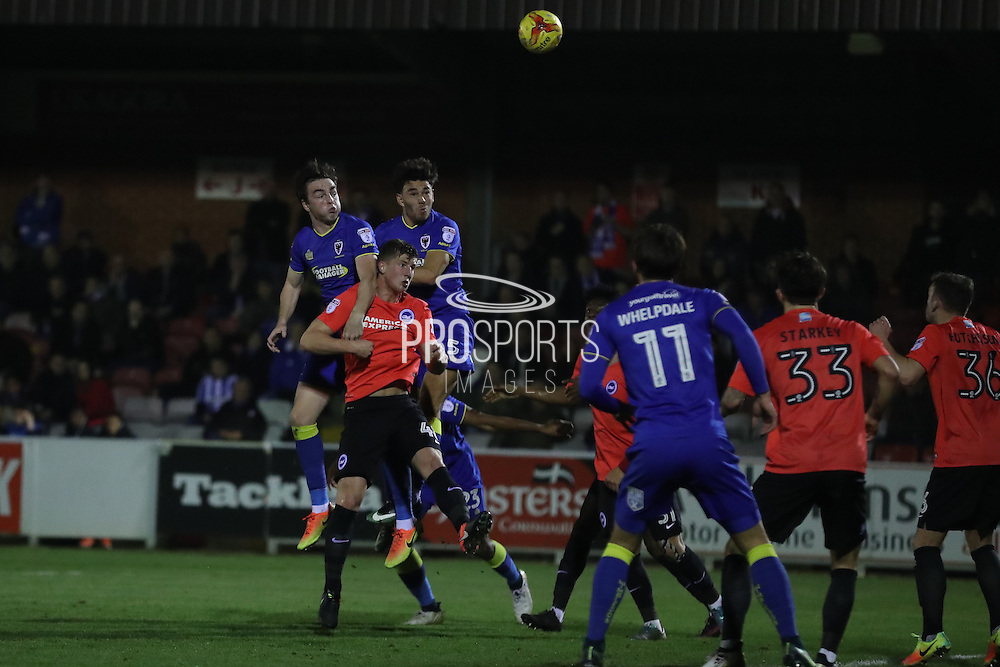 AFC Wimbledon defender Will Nightingale (5) and AFC Wimbledon defender Sean Kelly (22) jump for  the corner during the EFL Trophy match between AFC Wimbledon and U23 Brighton and Hove Albion at the Cherry Red Records Stadium, Kingston, England on 6 December 2016. Photo by Stuart Butcher.