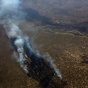 An arial view shows the blazing smoke of a bush fire in central South Sudan.