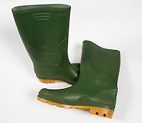 green wellington boot on a white background