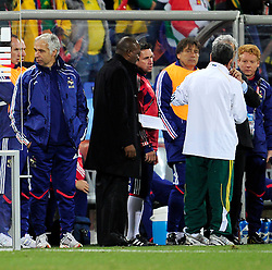 Raymond Domenech and Carlos Alberto Parreira exchange angry words at the end of the  2010 World Cup Soccer match between South Africa and France played at the Freestate Stadium in Bloemfontein South Africa on 22 June 2010.