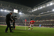 Ryan Giggs, Welsh football international player takes a corner during a Wales international match at the Millennium Stadium in Cardiff.